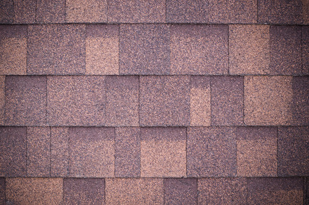 roof of new brown shingles background and texture. vignette