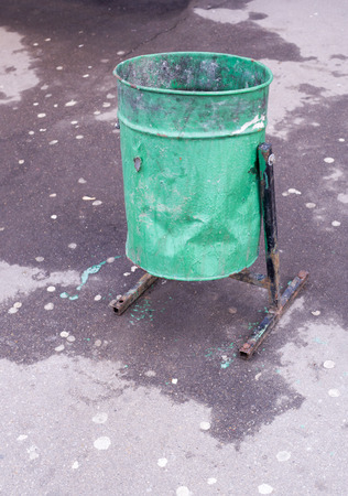 green metal garbage can on the street. citylife, objects Imagens