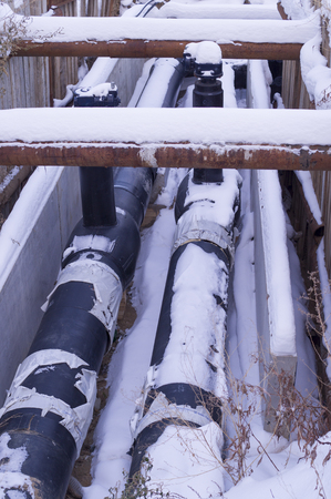industrial pipelines covered in snow. construction, transportation.