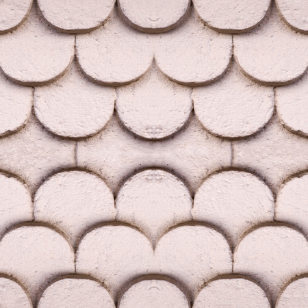 seamless beige wall with decorative semicircles texture. background.