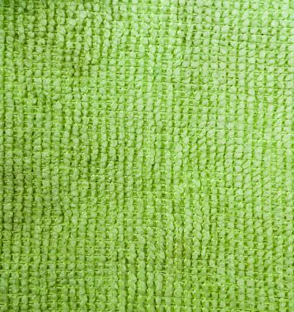 green fabric towel background. texture, domestic Reklamní fotografie
