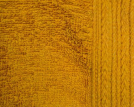 orange fabric towel background. texture, domestic