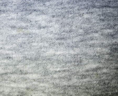 gray knitted fabric textile texture. background, close-up