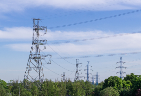 power transmission line at summer in the city. industrial, nature.