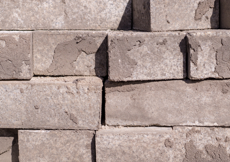 stack of gray pavement cobblestones, bricks. texture, construction.