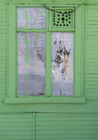 window in old green wooden house. background, architecture.