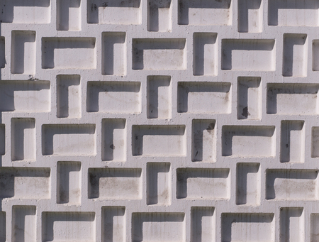 textured concrete fence painted white. background, texture.