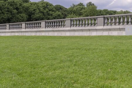 green grass with marble fence on the background. nature, architecture