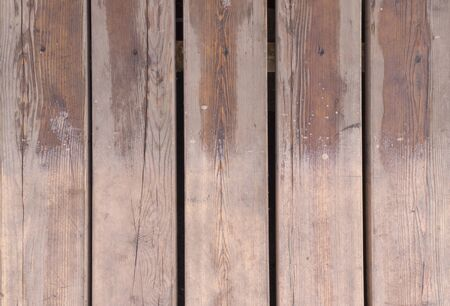 partially wet brown wooden planks texture. background