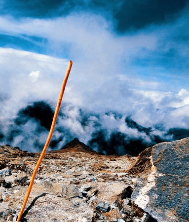 handmade cane placed on the top of the mountain that represents the achievement of reaching the summit Banco de Imagens