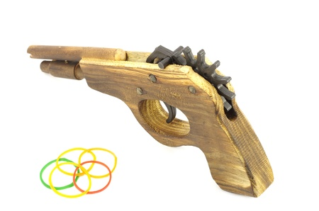 Wooden Catapult Gun with rubber on white background Stock Photo - 18439639