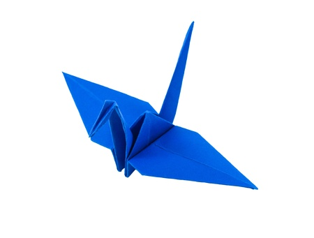 origami blue paper bird on white background photo