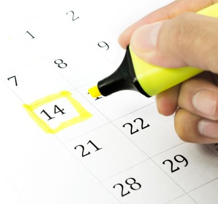 Mark on the calendar at 14. Yellow color. Banco de Imagens
