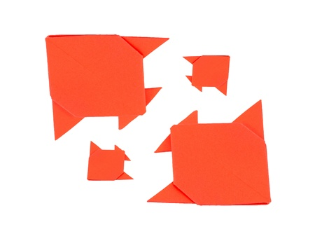 four orange fish origami from paper on white background Stock Photo - 19123982