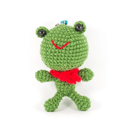 handmade crochet green frog doll on white background photo