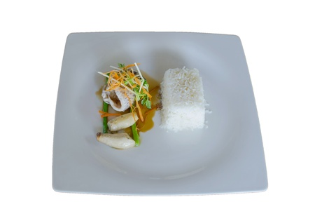 serv: grilled fillet of seabass with teriyaki sauce, serv with stream rice on white background Stock Photo