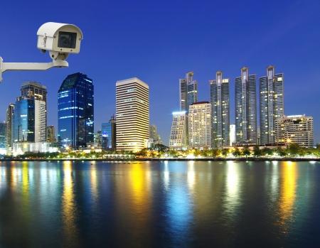 Security camera monitoring the Bangkok city river side at twilight photo