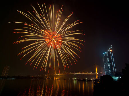 Multicolor fireworks night scene, bangkok cityscape river view, over big bridge photo