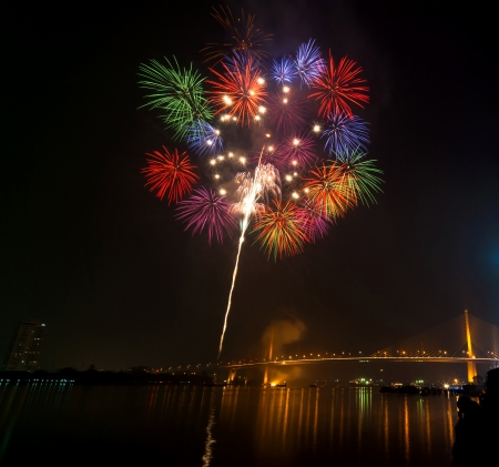 Happy New Year fireworks night scene, bangkok cityscape river view, over big bridge photo