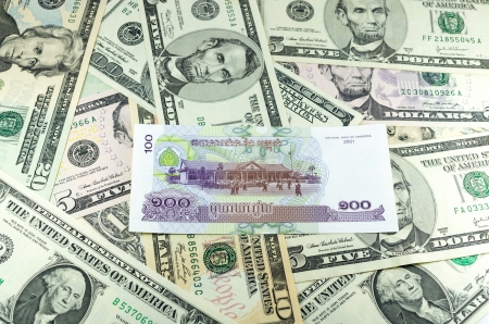 riel: Cambodian Riel  KHR  on many dollars background
