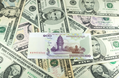 riel: hundred Cambodian Riel (KHR) on many dollars background