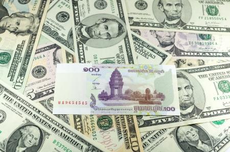 riel: hundred Cambodian Riel (KHR) on many dollars background