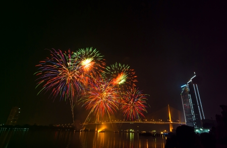 Multicolor fireworks night scene, bangkok cityscape river view, over big bridge photo