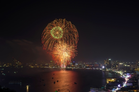 Multicolor fireworks night scene, pattaya cityscape sea beach view, thailand photo