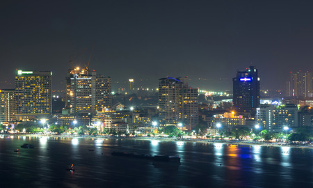 Pattaya cityscape Modern building sea beach side at night time,Thailand photo