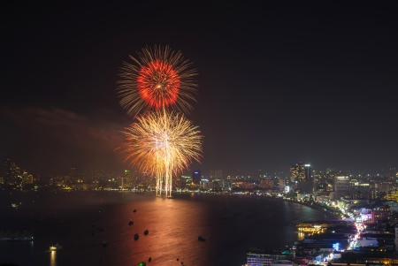 Beautiful big fireworks at night on pattaya cityscape, thailand photo