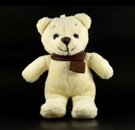TEDDY BEAR yellow color with scarf on black background