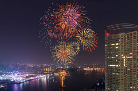 Happy New Year fireworks night scene, bangkok cityscape river view photo