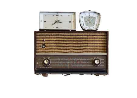 sliding scale: oldie radios and clock on white background