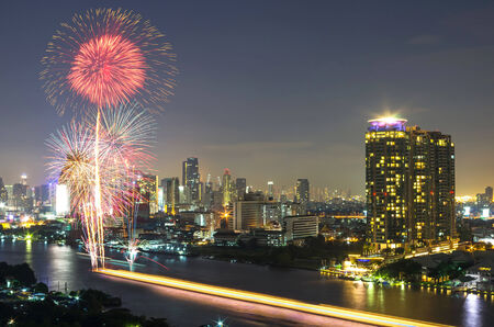 fireworks with bangkok cityscape river view at twilight scene, thailand photo