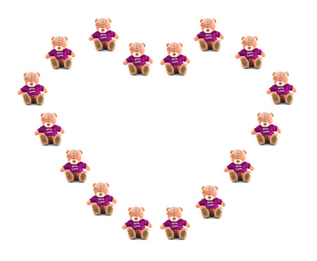 Heart Love of hand made TEDDY BEAR pink color with purple shirt on white background Banco de Imagens
