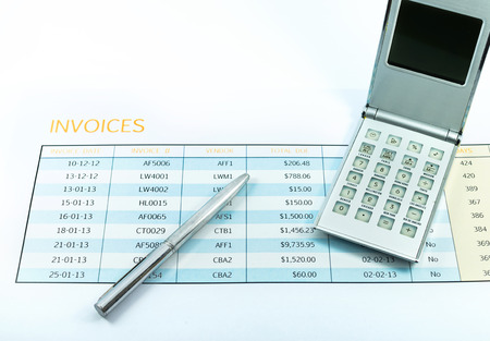 invoice report with calculator and pen for business photo