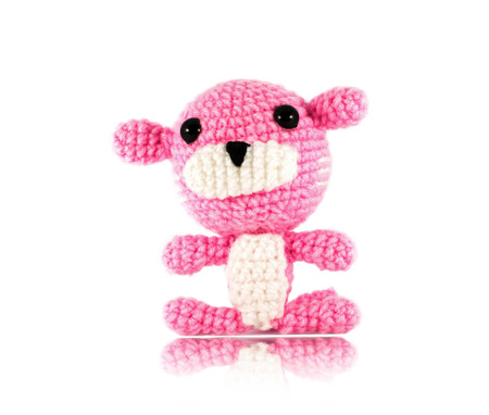 handmade crochet pink tiger doll on white  photo