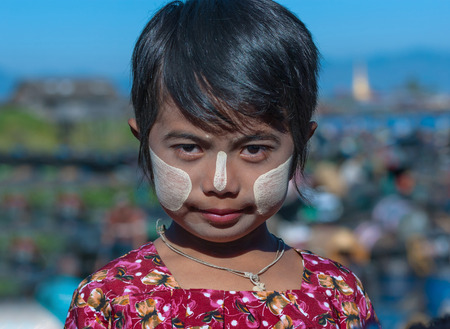 INLE LAKE, MYANMAR - DEC 31: face of unidentified the young girl  burmese with traditional thanaka, on December 31, 2010 in Inle Lake, Myanmar.