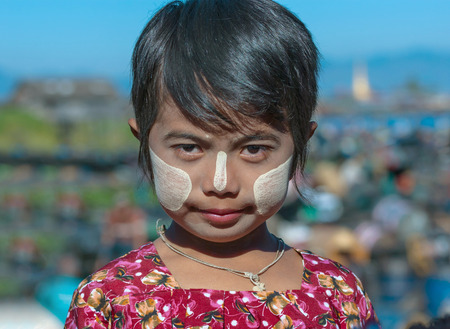 INLE LAKE, MYANMAR - DEC 31: face of unidentified the young girl  burmese with traditional thanaka, on December 31, 2010 in Inle Lake, Myanmar. Editorial