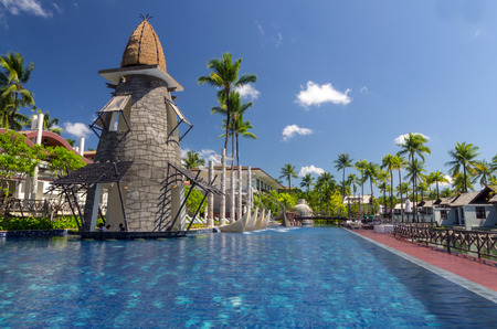 graceland: KHAOLAK, THAILAND - NOV 3 : Architecture exterior with swimming pool of the SENTIDO Graceland Khao Lak Resort & Spa.is located 90 kilometres north of Phuket, on November 3, 2013 in Khaolak, Thailand