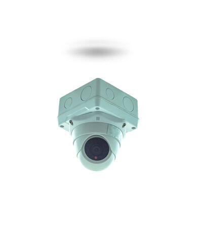 paranoia: CCTV security camera in building on white background, isolate