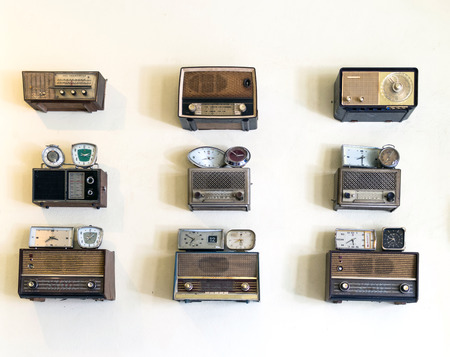 sliding scale: set of oldie radios and clock