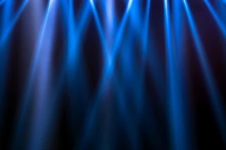 spot: blue luminous rays on a dark background