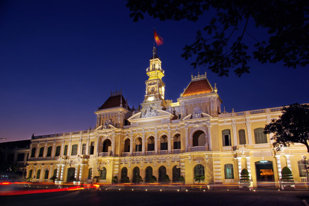 committee: The Peoples Committee building at twilight in Hochiminh city, Vietnam