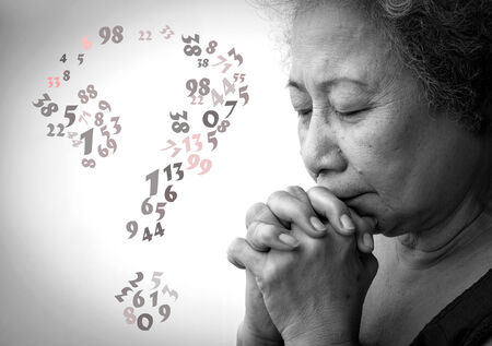 Old woman praying with lucky number