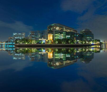 Modern Building river side at twiligjt time, hospital building in Bangkok,thiland photo