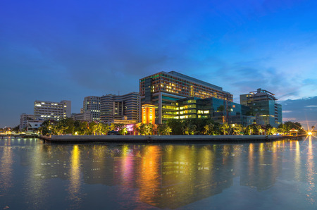 Modern Building river side at evening time, hospital building in Bangkok,thailand Stock Photo - 32331521
