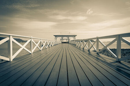 Beautiful wooden pier at Koh Si Chang island, Thailand photo