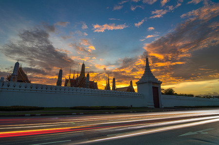 grand palace of Thailand or Wat Phra Kaew in bangkok when sunset with traffic light photo