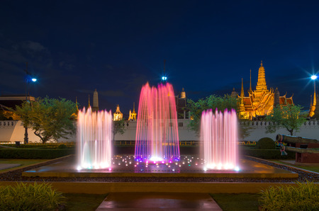 waterworks: Waterworks with Grand palace background twilight time in Bangkok, Thailand Stock Photo